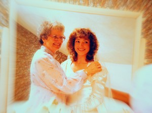 Mom helping me dress wedding day 1982